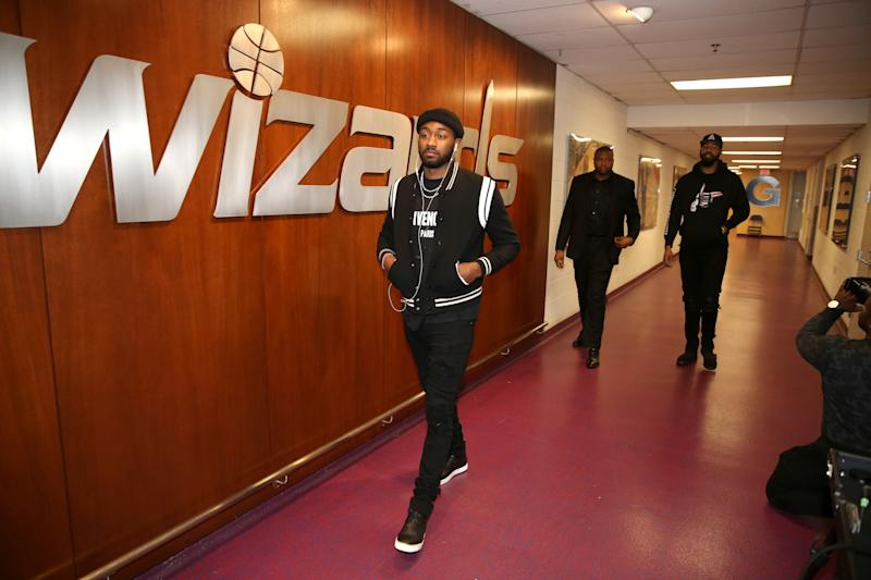 John Wall enters Verizon Center on some all black everything. (Getty Images)