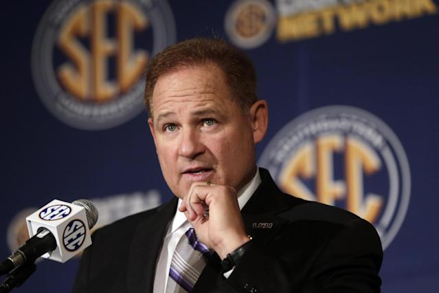 "FILE - In this July 18, 2013 file photo, LSU coach Les Miles talks with reporters during the Southeastern Conference football Media Days in Hoover, Ala. Miles says he's proud of his time as head coach at Oklahoma State. The LSU coach says those making allegations in Sports Illustrated of academic fraud at Oklahoma State, or improper payments to players from boosters, ""weren't there long enough to figure it out,"" because they were dismissed from the program. (AP Photo/Dave Martin, File)"