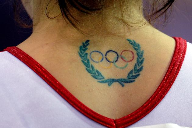 Nathalia Sanchez of Colombia is seen with a tattoo of the Olympic rings on her neck during the Women's Artistic Gymnastics Finals in Uneven Bars during Day 13 of the XVI Pan American Games at the Revolution Sports Complex on October 27, 2011 in Guadalajara, Mexico. (Photo by Dennis Grombkowski/Getty Images)