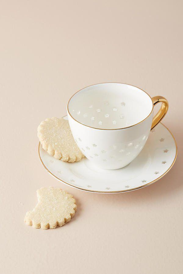 "A <a href=""https://www.anthropologie.com/shop/estrella-cup-saucer?category=kitchen-mugs-teacups&color=010"" target=""_blank"">cute mug and saucer set</a> is perfect for a chilly winter morning."