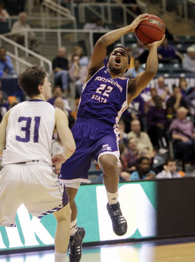Northwestern State guard Brison White (22) shoots off balance as Stephen F. Austin's Connor Brooks (31) defends during the first half of an NCAA college basketball game in the semifinal round of the Southland Conference tournament Friday, March 14, 2014, in Katy. (AP Photo/Bob Levey)