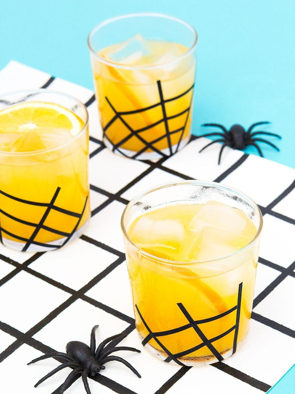 """<p>Spiced simple syrup, orange juice, and gin join forces in this sweet, autumnal drink. Included in the recipe is a DIY tutorial for the spider glassware detailing to add a spooky touch. </p><p><strong>Get the recipe at <a href=""""https://sarahhearts.com/spiced-gin-and-juice/"""" rel=""""nofollow noopener"""" target=""""_blank"""" data-ylk=""""slk:Sarah Hearts"""" class=""""link rapid-noclick-resp"""">Sarah Hearts</a>. </strong></p><p><strong><a class=""""link rapid-noclick-resp"""" href=""""https://www.amazon.com/Bormioli-Rocco-Bodega-Collection-Glassware/dp/B000PG9BZO/?tag=syn-yahoo-20&ascsubtag=%5Bartid%7C2164.g.36792938%5Bsrc%7Cyahoo-us"""" rel=""""nofollow noopener"""" target=""""_blank"""" data-ylk=""""slk:SHOP GLASSES"""">SHOP GLASSES</a></strong></p>"""