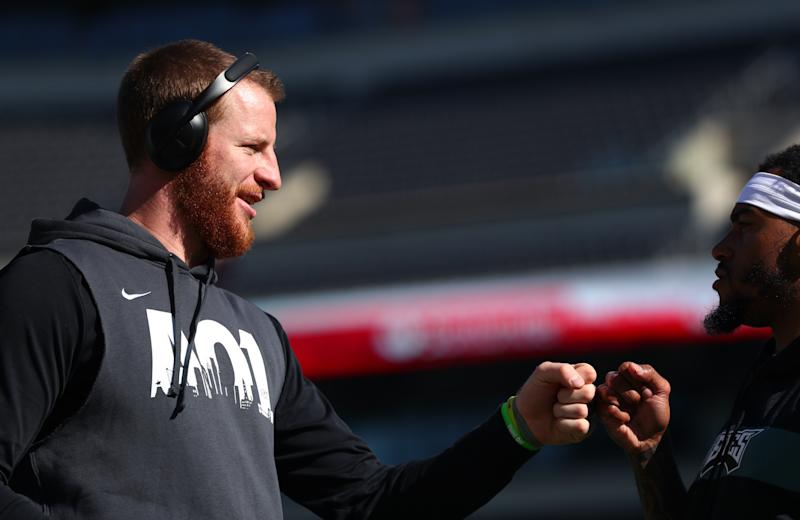 PHILADELPHIA, PA - NOVEMBER 03: Philadelphia Eagles Quarterback Carson Wentz (11) bumps fists with Philadelphia Eagles Wide Receiver DeSean Jackson (10) before the game between the Chicago Bears and Philadelphia Eagles on November 03, 2019 at Lincoln Financial Field in Philadelphia, PA. (Photo by Kyle Ross/Icon Sportswire via Getty Images)