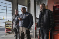"""This image released by Netflix shows Marshall Williams, from left, Laurence Fishburne and Liam Neeson in a scene from """"The Ice Road."""" (Allen Fraser/Netflix via AP)"""