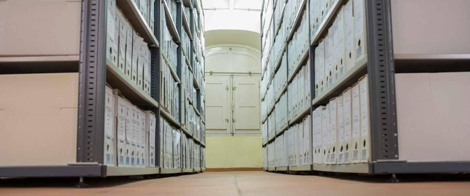 Historical archive warehouse full of carton boxes. Low angle shot