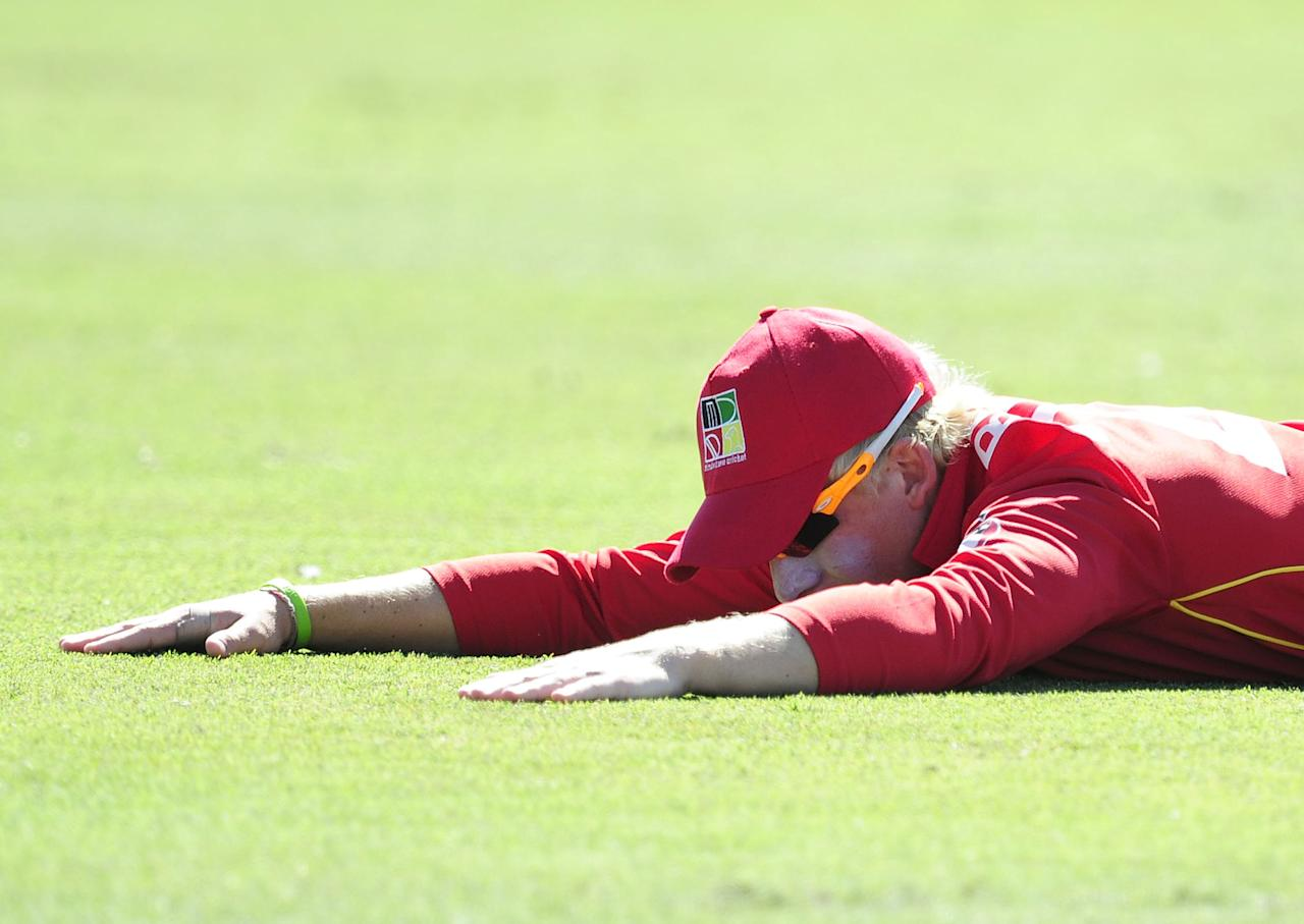 TOWNSVILLE, AUSTRALIA - AUGUST 14:  Matthew Bentley of Zimbabwe lays on the ground after misfielding a ball during the ICC U19 Cricket World Cup 2012 match between India and Zimbabwe at Tony Ireland Stadium on August 14, 2012 in Townsville, Australia.  (Photo by Ian Hitchcock-ICC/Getty Images)