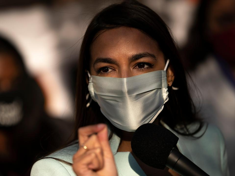 US Rep Alexandria Ocasio-Cortez speaks outside of the Democratic National Committee headquarters on 19 November, 2020 in Washington, DC. (Getty Images)