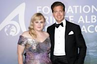 """<p>The <i>Pitch Perfect</i> star and her boyfriend Jacob Busch <a href=""""https://people.com/movies/rebel-wilson-splits-from-boyfriend-jacob-busch/"""" rel=""""nofollow noopener"""" target=""""_blank"""" data-ylk=""""slk:have split, PEOPLE confirmed"""" class=""""link rapid-noclick-resp"""">have split, PEOPLE confirmed</a> on Feb. 2. </p> <p>Wilson, 40, referred to herself as a """"single girl"""" on Instagram, sharing a photo of herself along with the caption, """"Lots on my mind...aghhhhhh...<a href=""""https://www.instagram.com/explore/tags/single/"""" rel=""""nofollow noopener"""" target=""""_blank"""" data-ylk=""""slk:#single"""" class=""""link rapid-noclick-resp"""">#single</a>-girl-heading-to-Super-Bowl!""""</p> <p>Speaking to PEOPLE, a friend of the star said, """"Jacob was an amazing guy but just not the one for her long-term.""""</p> <p>Here, we've rounded up everything to know about the couple's whirlwind romance. </p>"""