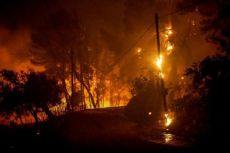 Flames were moving closer to the ancient site of Olympia Wednesday night