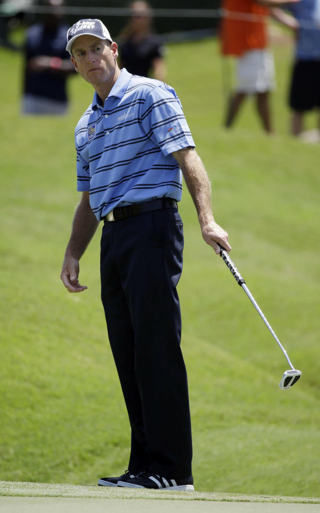 Jim Furyk reacts after missing a par putt on the ninth hole during the second round of The Players championship golf tournament at TPC Sawgrass, Friday, May 9, 2014, in Ponte Vedra Beach, Fla. (AP Photo/John Raoux)