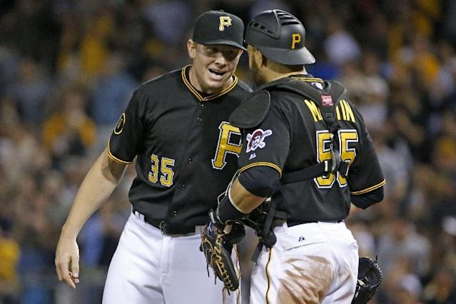 Pittsburgh Pirates relief pitcher Mark Melancon (35) celebrates with catcher Russell Martin (55) after getting the final out of the ninth inning in a baseball game against the Washington Nationals in Pittsburgh, Saturday, May 24, 2014. The Pirates won 3-2, with Melancon getting the save. (AP Photo/Gene J. Puskar)