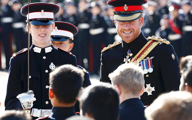Prince Harry inspects the student guards during his visit to The Duke of York's Royal Military School on September 28, 2015 - Credit: Eddie Keogh - WPA Pool/Getty Images