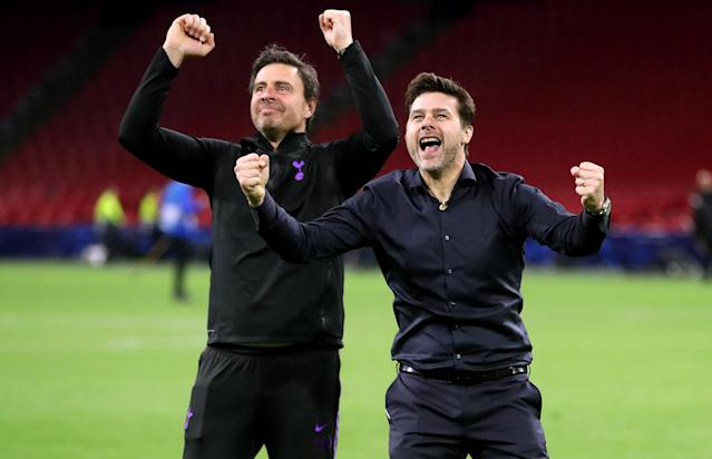 Mauricio Pochettino and Miguel D'Agostino celebrate with the fans after teh astonishing comeback
