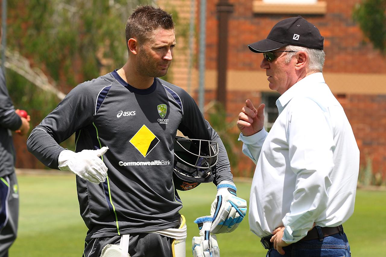 BRISBANE, AUSTRALIA - NOVEMBER 06:  Michael Clarke and Allan Border talk during an Australian nets session at The Gabba on November 6, 2012 in Brisbane, Australia.  (Photo by Chris Hyde/Getty Images)