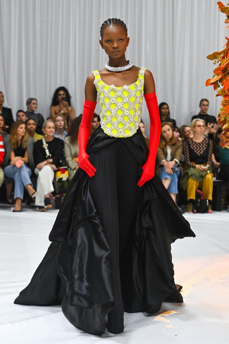 """<p>Richard Quinn closed London Fashion Week with a show and cocktail party at The Londoner, which drew in an A-list crowd, including <a href=""""https://www.harpersbazaar.com/uk/fashion/fashion-news/a37686524/kate-moss-lila-richard-quinn/"""" rel=""""nofollow noopener"""" target=""""_blank"""" data-ylk=""""slk:supermodel Kate Moss, who was on hand to support her daughter Lila on the catwalk"""" class=""""link rapid-noclick-resp"""">supermodel Kate Moss, who was on hand to support her daughter Lila on the catwalk</a>. The show, which marked Quinn's return to the catwalk after lockdown and his first since February 2020, was an emotional one for the designer. Describing the collection as a contrast between """"tension and calm"""", it was filled with many of the eccentric prints and over-the-top silhouettes that he has become so well known for, and which are always a favourite on the red carpet.</p>"""