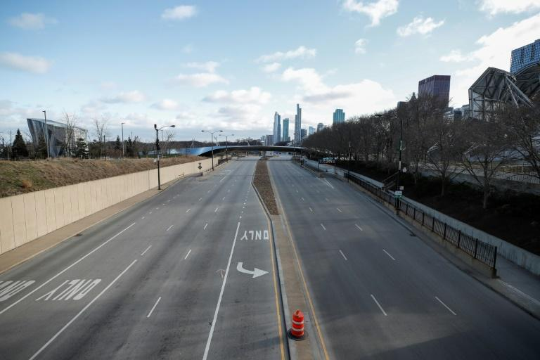 Columbus Drive is seen empty in downtown Chicago, Illinois, on March 21, 2020