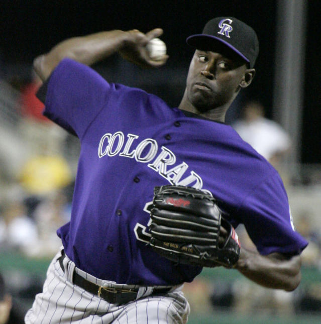 FILE - This July 16, 2007 file photo shows Colorado Rockies relief pitcher LaTroy Hawkins throwing against the Pittsburgh Pirates during a baseball game in Pittsburgh. Hawkins is returning to the Rockies and the veteran reliever may just possibly wind up as their closer. Hawkins agreed to a one-year, $2.5 million deal on Tuesday, Nov. 19, 2013, a person familiar with the negotiations told The Associated Press. (AP Photo/Gene J. Puskar, File)