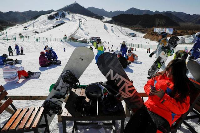 Visitors enjoy the snowboarding section at Nanshan ski resort, east of Beijing, China January 23, 2018. REUTERS/Damir Sagolj