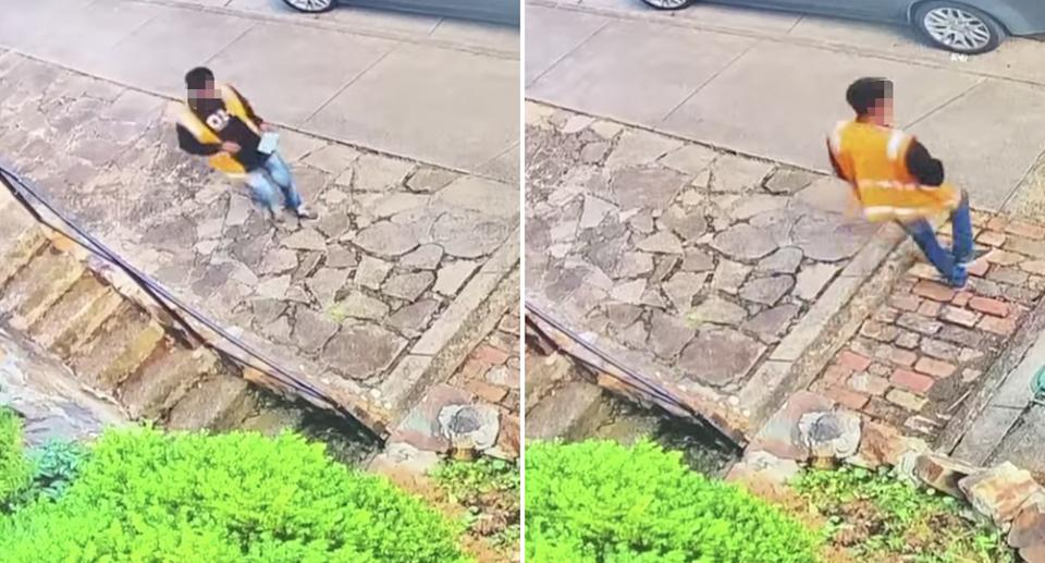 An Australia Post worker drops a delivery slip off in a mailbox before leaving.
