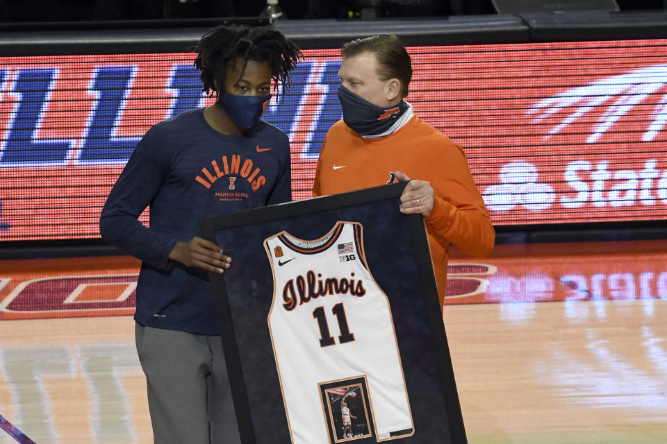 Illinois' Ayo Dosunmu, a graduating senior, is honored before the team's last home game of the NCAA basketball season, against Nebraska on Thursday, Feb. 25, 2021, in Champaign, Ill. (AP Photo/Holly Hart)