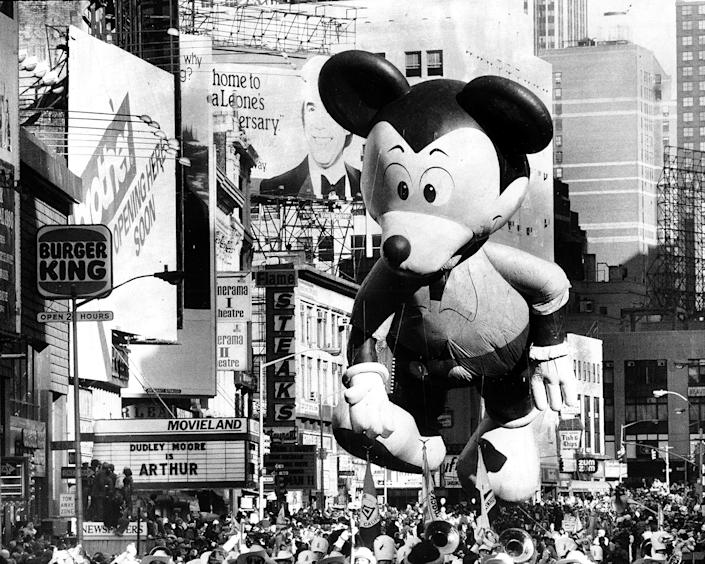 Mickey Mouse takes in Broadway's sights, including a crowd of more than a million, at the 55th annual Macy's Thanksgiving Day Parade on Nov. 26, 1981. (Photo: Harry Hamburg/New York Daily News Archive/Getty Images)