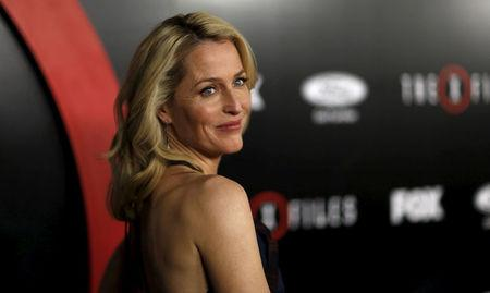 """FILE PHOTO:  Gillian Anderson poses at a premiere for """"The X-Files"""" at California Science Center in Los Angeles"""