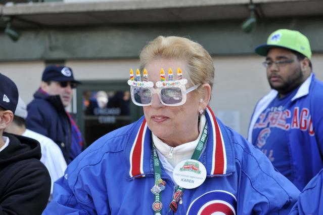 CHICAGO, IL - APRIL 23: A Cubs usher wears birthday sunglasses before the game between the Chicago Cubs and the Arizona Diamondbacks on April 23, 2014 at Wrigley Field in Chicago, Illinois. Today marks the 100th anniversary of the first game ever played in the historic venue. (Photo by David Banks/Getty Images)