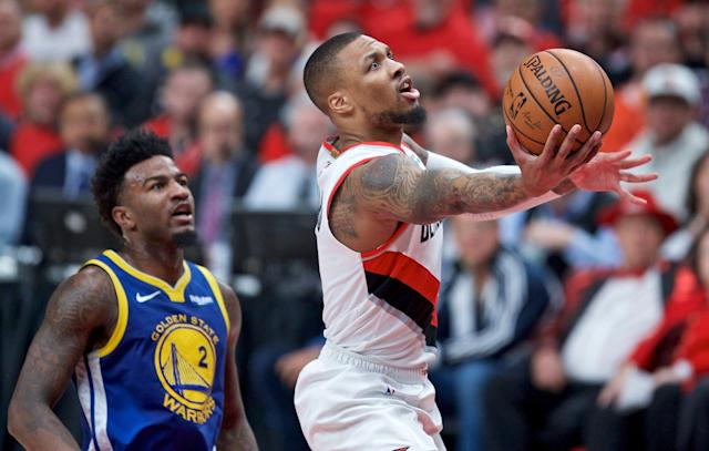 Blazers guard Damian Lillard goes to the hoop during the first half of Game 4 of the Western Conference finals Monday. (AP)