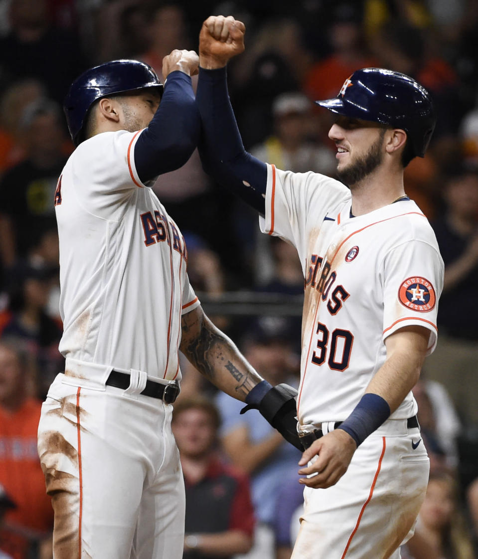 Houston Astros' Kyle Tucker (30) celebrates his two-run home run with Carlos Correa during the seventh inning of a baseball game against the Texas Rangers, Saturday, May 15, 2021, in Houston. (AP Photo/Eric Christian Smith)