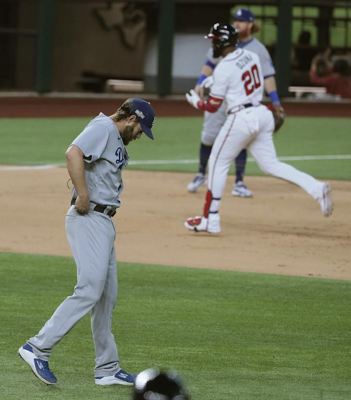 Atlanta Braves designated hitter Marcell Ozuna rounds the bases after hitting a home run off Clayton Kershaw.
