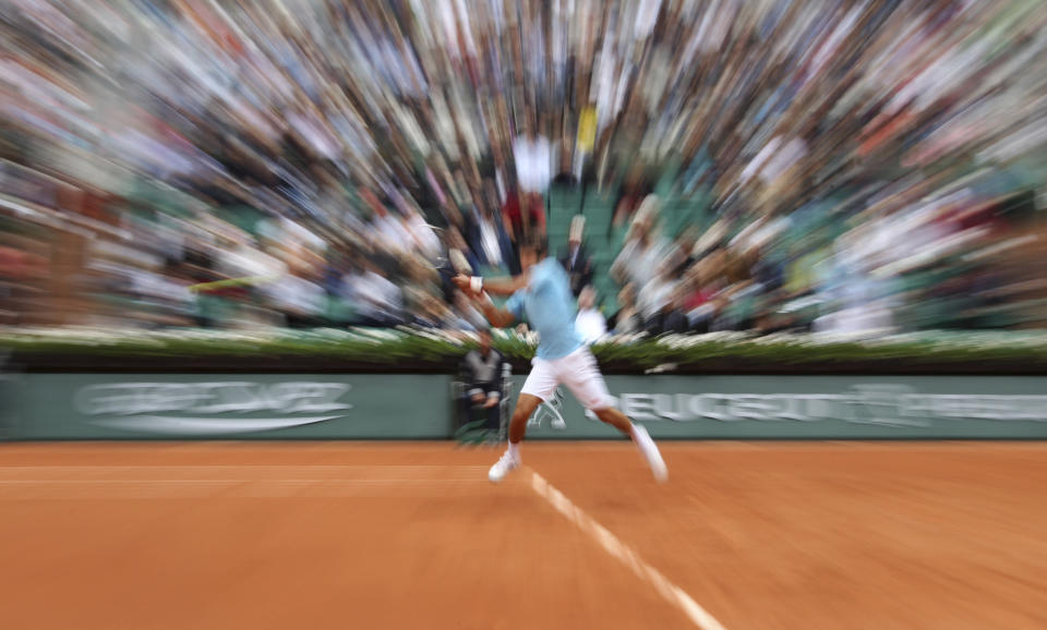 FILE - This May 13, 2014, file photo shows Serbia's Novak Djokovic as he returns the ball during a third round match of the French Open tennis tournament against Croatia's Marin Cilic at Roland Garros stadium in Paris. (AP Photo/David Vincent, File)
