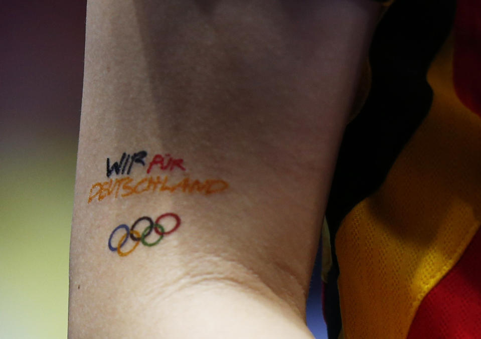 Germany's Wu Jiaduo sports an Olympic tattoo that reads 'Wir fur Deutschland' (we for Germany) in their women's team first round table tennis match against Australia at the ExCel venue during the London 2012 Olympic Games August 3, 2012. REUTERS/Grigory Dukor (BRITAIN - Tags: OLYMPICS SPORT TABLE TENNIS)