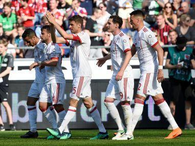 Bundesliga champions Bayern Munich won 3-0 at Hanover 96 on Saturday as Thomas Mueller and Robert Lewandowski both scored after coming off the bench.