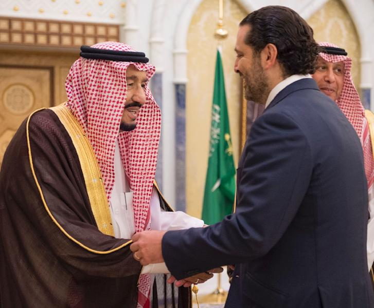 Saudi Arabia has supported Saad Hariri for years (shown with King Salman bin Abdulaziz al-Saud), hoping he would fight back against what it sees as Iran's main instrument in the region -- Lebanon's powerful Shiite armed movement Hezbollah (AFP Photo/BANDAR AL-JALOUD)