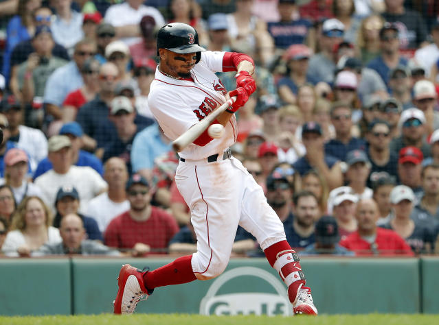 Boston Red Sox's Mookie Betts connects on a hit during the 10th inning of their 6-2 over the Toronto Blue Jays in a baseball game Saturday, July 14, 2018, in Boston. (AP Photo/Winslow Townson)