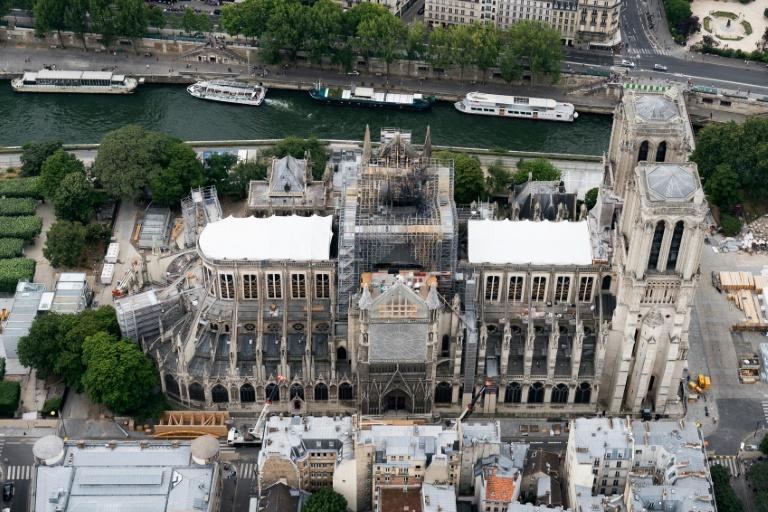 Three months after the fire the race to make good the extensive damage to the UNESCO world heritage site is on -- but the issue is a political hot potato, not least on grounds of cost