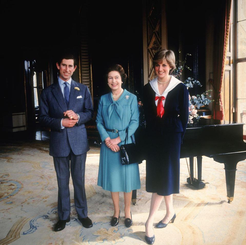<p>It wasn't just after joining the royal family that Diana sported sailor style fashions. Here, she poses with Prince Charles and the Queen, four months before her royal wedding.<br></p>