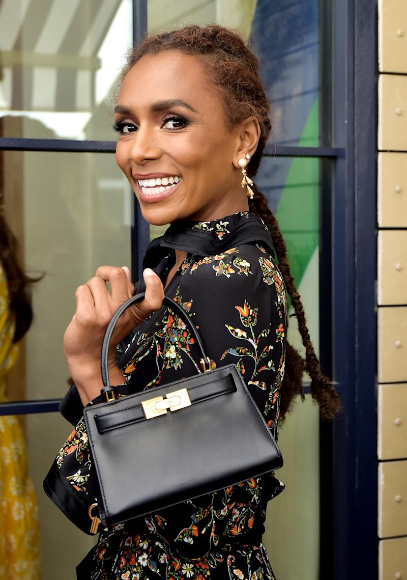 Janet Mock is wearing the Resort 2020 Printed Ruffle Wrap Dress, Lee Radziwill Petite Bag, Poetry of Things Pearl Earring, and Oversized Inlay Sunglasses.