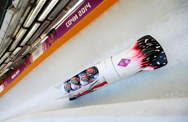 SOCHI, RUSSIA - FEBRUARY 23: Pilot Dawid Kupczyk, Daniel Zalewski, Michal Kasperowicz and Pawel Mroz of Poland team 1 make a run during the Men's Four Man Bobsleigh on day 16 of the Sochi 2014 Winter Olympics at Sliding Center Sanki on February 23, 2014 in Sochi, Russia. (Photo by Mike Ehrmann/Getty Images)