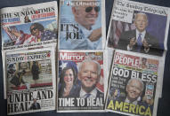 A selection of the British national newspapers on Sunday, Nov. 8, 2020, showing their front page reactions to President-elect Joe Biden and Vice President-elect Kamala Harris winning in the US election, in London. (AP Photo/Alastair Grant)