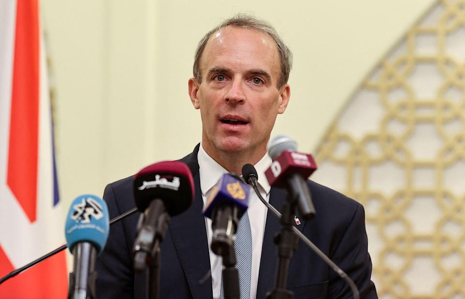Dominic Raab speaks at a press conference in Doha (AFP via Getty Images)