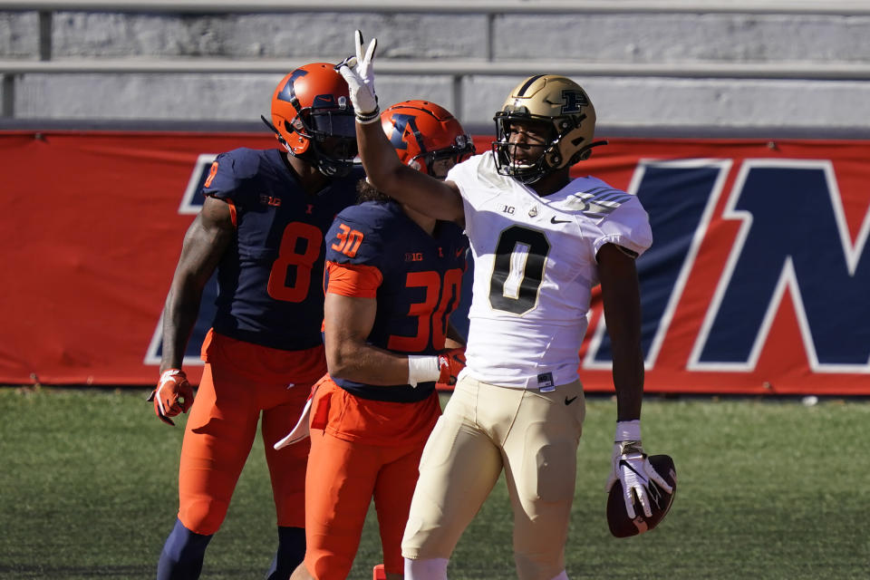 Purdue wide receiver Milton Wright, right, celebrates his touchdown reception as Illinois defensive back Sydney Brown (30) and Nate Hobbs watch during the first half of an NCAA college football game Saturday, Oct. 31, 2020, in Champaign, Ill. (AP Photo/Charles Rex Arbogast)