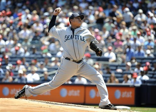 Seattle Mariners starting pitcher Felix Hernandez throws against the New York Yankees in the first inning of a baseball game on Saturday, Aug. 4, 2012, at Yankee Stadium in New York. Hernandez pitched a complete game in the Mariners 1-0 win. (AP Photo/Kathy Kmonicek)