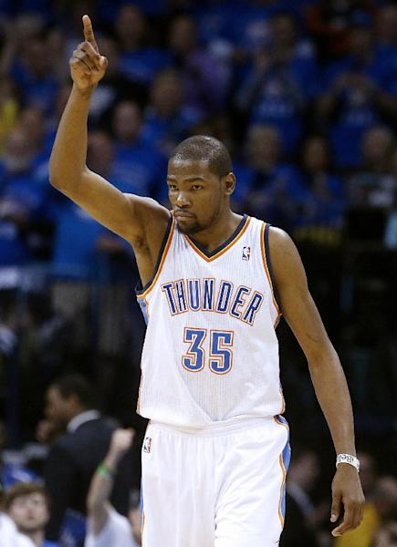 Oklahoma City Thunder forward Kevin Durant (35) gestures in the third quarter of Game 2 in their first-round NBA basketball playoff series against the Houston Rockets in Oklahoma City, Wednesday, April 24, 2013. Oklahoma City won 105-102. (AP Photo/Sue Ogrocki)