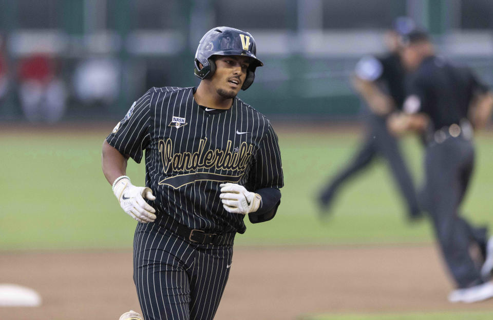 Vanderbilt's Jayson Gonzalez rounds the bases after hitting a two-run home run against Arizona in the fifth inning during a baseball game in the College World Series, Saturday, June 19, 2021, at TD Ameritrade Park in Omaha, Neb. (AP Photo/Rebecca S. Gratz)