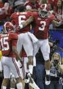 Alabama's Trent Richardson (3) celebrates a touchdown run during the second half of the BCS National Championship college football game against LSU Monday, Jan. 9, 2012, in New Orleans. (AP Photo/Gerald Herbert)