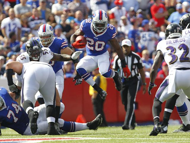 Buffalo Bills running back C.J. Spiller (28) runs against the Baltimore Ravens during the first half of an NFL football game on Sunday, Sept. 29, 2013, in Orchard Park, N.Y. (AP Photo/Bill Wippert)