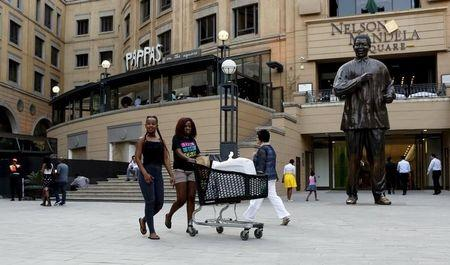 File photo of shoppers pushing trolleys at an upmarket shopping mall in Sandton, Johannesburg