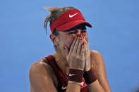 Belinda Bencic, of Switzerland, becomes emotional after defeating Elena Rybakina, of Kazakhstan, during the semifinals of the tennis competition at the 2020 Summer Olympics, Thursday, July 29, 2021, in Tokyo, Japan. (AP Photo/Seth Wenig)
