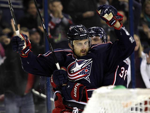 Columbus Blue Jackets' Nick Foligno, left, celebrates his goal against the Edmonton Oilers with teammate Boone Jenner in the second period of an NHL hockey game in Columbus, Ohio, Friday, Nov. 29, 2013. (AP Photo/Paul Vernon)